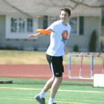 Senior Connor Rieg throws the frisbee across the field, after finding an open teammate. Photo by CJ Manne