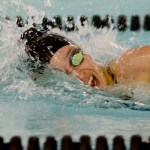 Junior Izzy Smith swims her 500 freestyle race. Photo by Luke Hoffman