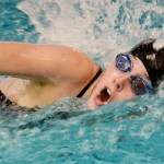 Senior Molly Hogan swims her 50 freestyle race. Photo by Luke Hoffman