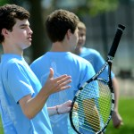 Freshman Will Luchinsky flips his racket while messing around before his match. Photo by Luke Hoffman
