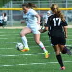 Sophomore Adelaine Marrone receives a pass and gains control of the ball. Photo by Luke Hoffman