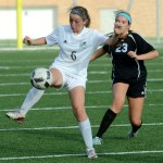 Freshman Maddie Reed receives a pass and attempts to gain control of the ball. Photo by Luke Hoffman