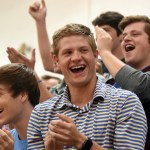 Senior Hayden Linscott claps along with the senior class after Jacob DeSett wins musical chairs for the senior class. Photo by Diana Percy