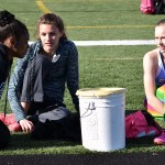 Sophomore Destiny Ray gives Carly Hendrickson and Jessie Stindt a pep talk before they compete in the high jump. Photo by Laini Reynolds