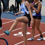 Junior Katie MacAdam warms up before she runs the first leg of the 4x100 meter relay. Photo by Laini Reynolds