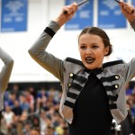 Junior Katie Faught looks at the crowd with intensity during the hip hop performance. Photo by Ellie Thoma