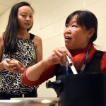 Ms. Lau, the Chinese teacher, works with senior Gracie Crabtree to prepare dumplings for Chinese Club. Photo by Ellie Thoma