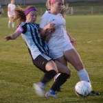Senior Josie Clough tries to steal the ball from her opponent before she has a chance to score. Photo by Ellen Swanson