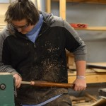 Shaping something for one of his wood designs, junior Nathan Cain concentrates hard on working on his project. Photo by Morgan Plunkett