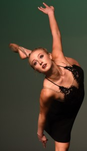 Senior Annie Smith poses on one leg during her senior solo. Photo by Morgan Browning