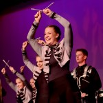 Senior Anna Dierks poses at the end of the varsity drill teams hip-hop number. Photo by Maddie Smiey
