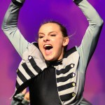 Junior Emma Renwick hits togehter two drum sticks during the drill team's dance from Nationals. Photo by Sophie Storbeck