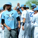 The Shawnee Mission East boys' varsity baseball team huddles up before the game. Photo by Luke Hoffman