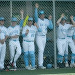 Members of the Shawnee Mission East baseball team look out at the game from their home dugout. Photo by Luke Hoffman