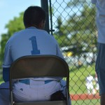 Freshman Robert Moore watches the last play of the game. The Lancers scored their 15th run, invoking the mercy rule.