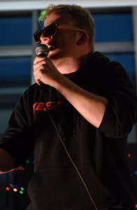 Senior Deegan Pores amps up the crowd before he begins his rap performances. Photo by Lucy Morantz