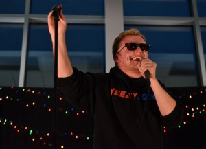 Senior Deegan Pores laughs into the microphone after a verse in his song. Photo by Lucy Morantz
