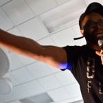 Teacher David Muhammad leans out to the crowd during his rap verse. Photo by Lucy Morantz
