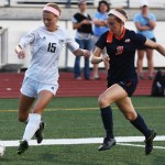 Junior Maddy Muther dribbles the ball towards the goal. Photo by Carson Holtgraves