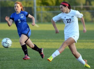Senior Jessica Parker passes the ball to a nearby teammate. Photo by Ellen Swanson