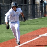 Freshman Robert Moore runs to home plate scoring the first run. Photo by Izzy Zanone