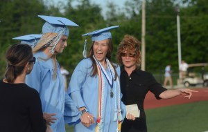 Seniors Kendall Dunbar and Lilly Flint grab hands as before walking together. Photo by Grace Chisholm.