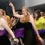 "Senior Meredith Kruse steps to the ""Cha Cha Slide"" with the other Link Crew members."