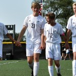 Boys soccer C team walks up to the stands to take a bow after winning their game against D team. Photo by Lucy Morantz