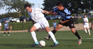 Sophomores TJ Libeer and Simon Robinson fight for the ball in the scrimmage. Photo by Morgan Plunkett