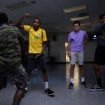 Off to the side of the dance, freshmen Jerevon, Dawah, Justin and Trenton practice their dance moves together. Photo by Ellie Thoma