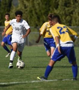 Freshman Sean Brookes runs through his defenders toward the goal. Photo by Ellen Swanson