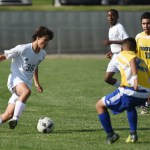 Sophomore Joseph Wagner attempts to weave through his opponents. Photo by Ellen Swanson