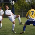 Sophomore Michale Venneman prepares to head the ball that the goalie kicked toward him. Photo by Ellen Swanson