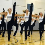 Varsity dancers (left to right) Hannah Goettsch, Emma Renwick, Toni Englund, Sophie Lawrence and Payton Lieb do a kick line during their performance. Photo by Katherine McGinness