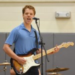 "Senior Sam Fay performs ""Year 3000"" by the Jonas brothers. Photo by Ellen Swanson"