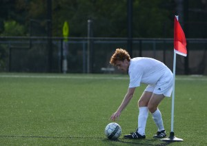 Senior Tommy Nelson sets up his ball before he kicks it. Photo by Reilly Moreland