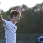 Junior Conor O'Toole puts his hands up in the air during the game. Photo by Reilly Moreland