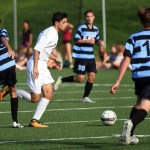 Junior Eren Eksinar runs to get the ball in hopes of scoring a goal running out the junior varsity players. Photo by Katherine Odell
