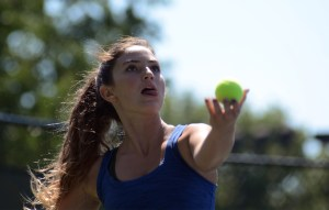 Sophomore Carolyn Popper prepares to serve. Photo by Ty Browning