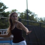 Sophomore Carolyn Popper hits the tennis ball during her doubles match. Photo by Ty Browning