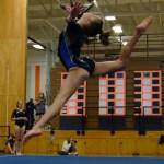 On the floor, sophomore Abby Gorman does a siscone leap. Photo by Aislinn Menke