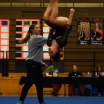 While being spotted by the team's coach Jennie Terflinger,  sophomore Brooklyn Beck does two back handsprings into a back tuck. Photo by Aislinn Menke