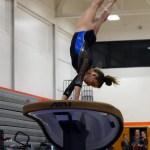 Sophomore Abby Gorman does a half on half off vault. Photo by Aislinn Menke