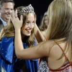 Senior Toni England is crowned homecoming queen by East alum Ellie Booton. Photo by Diana Percy