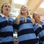 Seniors Libby Frye, Emma Linscott and Anna McClelland sing the school song with the senior class. Photo by Audrey Kesler