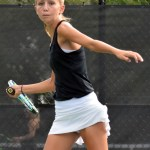 Freshman Allison Wilcox hits a backhand across the court to her opponent. Photo by Audrey Kesler