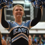 Senior Lauren Packel cheers on the crowd as students start coming in the gym. Photo by Morgan Plunkett