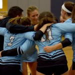 The freshman and sophomore girls volleyball team gets psyched up for their match. Photo by Luke Hoffman
