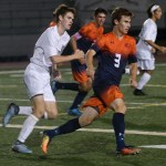 Junior Conor O'Toole races towards his teammate to assist in the play. Photo by Izzy Zanone