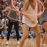 Senior Ally Huffman twirls a hulu hoop around her neck during mock America's Got Talent. Photo by Ellen Swanson